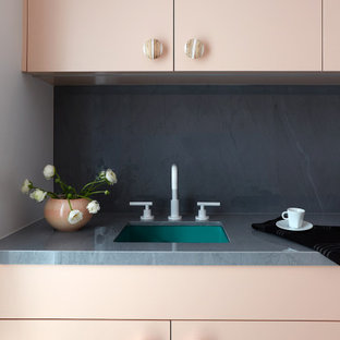 This is an example of a large eclectic separated utility room in Los Angeles with flat-panel cabinets, marble worktops, white walls and blue worktops.