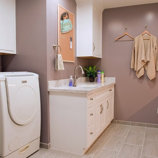 Design ideas for a large traditional u-shaped separated utility room in Orange County with a submerged sink, white cabinets, engineered stone countertops, purple walls, porcelain flooring, a side by side washer and dryer and shaker cabinets.