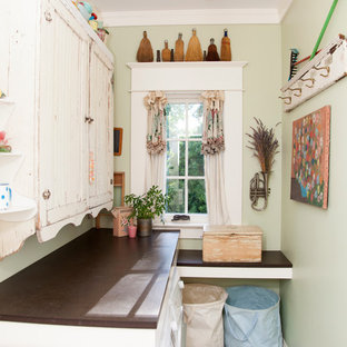 Inspiration for a shabby-chic style laundry room remodel in Portland with brown countertops