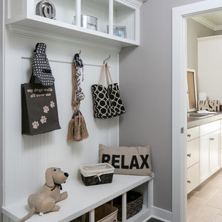 Inspiration for a mid-sized craftsman porcelain floor and beige floor laundry room remodel in Other with a drop-in sink, shaker cabinets, white cabinets, wood countertops and gray walls