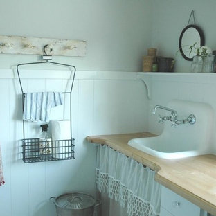 Inspiration for a traditional laundry room in Other with a drop-in sink, wood benchtops and beige benchtop.