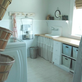Design ideas for a country laundry room in Other with a drop-in sink and wood benchtops.