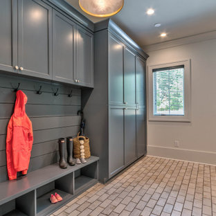 Inspiration for a large transitional u-shaped ceramic tile, white floor and shiplap wall utility room remodel in Atlanta with a drop-in sink, shaker cabinets, white cabinets, laminate countertops, white walls, a side-by-side washer/dryer and white countertops
