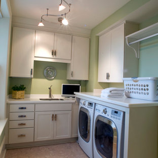 Example of a mid-sized transitional l-shaped cork floor dedicated laundry room design in Other with an undermount sink, recessed-panel cabinets, white cabinets, quartz countertops and green walls