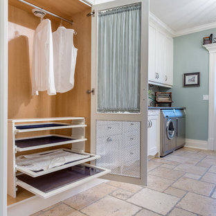Medium sized classic single-wall separated utility room in Ottawa with shaker cabinets, white cabinets, blue walls, a side by side washer and dryer, limestone flooring and beige floors.