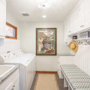 Example of a small eclectic galley porcelain tile and gray floor utility room design in Other with a drop-in sink, shaker cabinets, white cabinets, granite countertops, a side-by-side washer/dryer and white walls