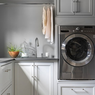 Transitional beige floor laundry room photo in Houston with an undermount sink, recessed-panel cabinets, gray walls, a side-by-side washer/dryer and gray countertops