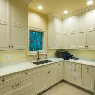 Design ideas for a large classic utility room in Seattle with recessed-panel cabinets and white cabinets.