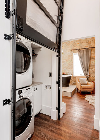 Industrial Laundry Room by Haven Builders Inc
