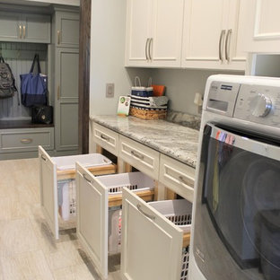 Example of a mid-sized single-wall utility room design in Other with flat-panel cabinets and a side-by-side washer/dryer