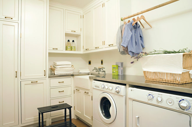 transitional laundry room by Tim Barber LTD Architecture & Interior Design