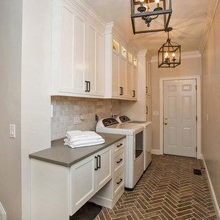 Example of a mid-sized cottage chic single-wall porcelain floor and brown floor dedicated laundry room design in Cincinnati with shaker cabinets, white cabinets, quartz countertops and gray walls