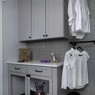 Inspiration for a large transitional gray floor utility room remodel in Detroit with gray cabinets, solid surface countertops, gray walls and white countertops