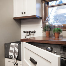 Rustic Laundry Room by EuroCraft Interiors Custom Cabinetry
