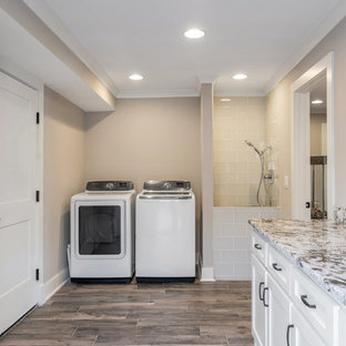 Mid-sized mountain style single-wall dark wood floor and brown floor utility room photo in Atlanta with an undermount sink, flat-panel cabinets, white cabinets, granite countertops, gray walls, a side-by-side washer/dryer and gray countertops