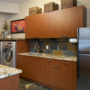 Example of a mountain style laundry room design in Boise with flat-panel cabinets and medium tone wood cabinets
