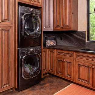This is an example of a large rustic utility room in Charlotte with beaded cabinets and brown cabinets.