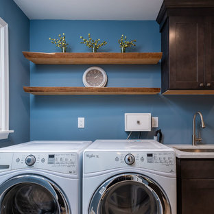 Inspiration for a small rustic utility room remodel in Philadelphia with an undermount sink, recessed-panel cabinets, brown cabinets, quartz countertops, blue walls, a side-by-side washer/dryer and multicolored countertops