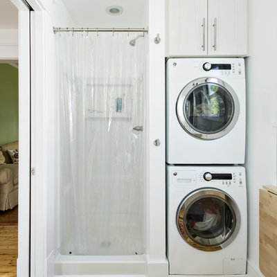 Elegant utility room photo in Louisville with a stacked washer/dryer