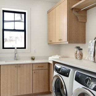 Example of a danish laundry room design in Minneapolis with light wood cabinets