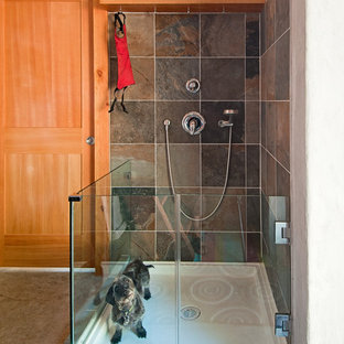 Example of a small mountain style concrete floor utility room design in Vancouver with gray walls