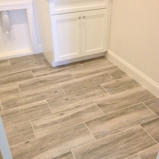 Small elegant porcelain floor laundry room photo in DC Metro with an undermount sink, white cabinets, quartz countertops and beige walls