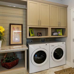 Idéer för små vintage beige tvättstugor, med luckor med profilerade fronter, beige skåp, granitbänkskiva, grå väggar, travertin golv, en tvättmaskin och torktumlare bredvid varandra och beiget golv