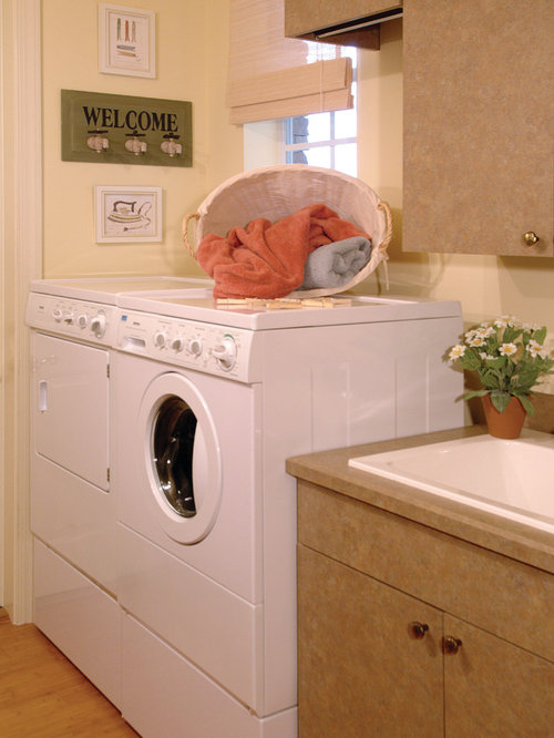 Large Laundry Room Design Ideas, Remodels & Photos with Brown Cabinets