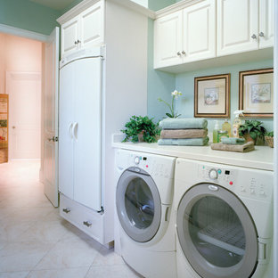 Inspiration for a large timeless ceramic tile utility room remodel in Miami with a drop-in sink, raised-panel cabinets, white cabinets, solid surface countertops, blue walls and a side-by-side washer/dryer