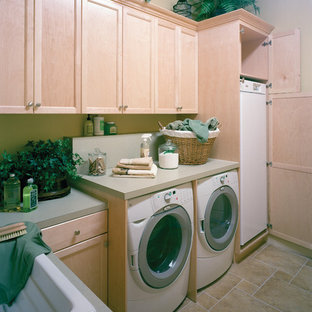 Design ideas for a large mediterranean galley separated utility room in Miami with a built-in sink, recessed-panel cabinets, light wood cabinets, laminate countertops, travertine flooring, a side by side washer and dryer and beige walls.