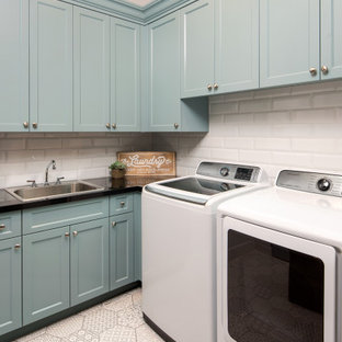 Medium sized rustic l-shaped separated utility room in Phoenix with a built-in sink, recessed-panel cabinets, blue cabinets, engineered stone countertops, grey walls, ceramic flooring, a side by side washer and dryer, white floors and black worktops.
