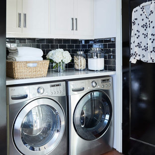 Small classic single-wall laundry cupboard in San Francisco with white cabinets, marble worktops, a side by side washer and dryer, shaker cabinets, dark hardwood flooring, brown floors, white worktops and white walls.