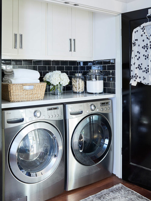 small singlewall dark wood floor and brown floor laundry closet photo in san