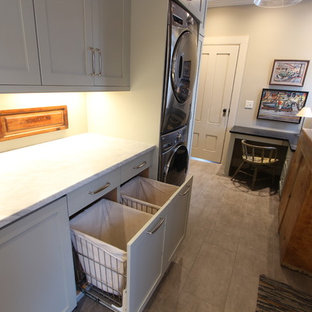 Sea Grass Painted Cabinets with Pull Out Hamper Storage