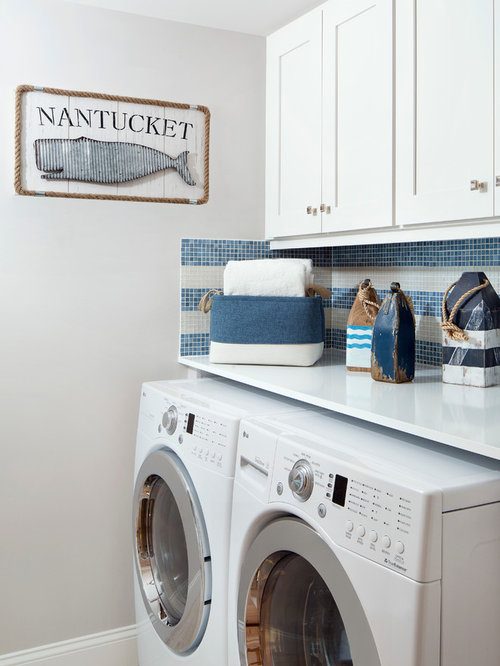 11 beach style laundry room design photos with wood countertops beach style laundry room