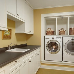Example of an arts and crafts laundry room design in Seattle with gray countertops and brown walls