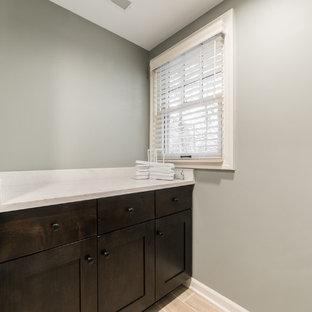 Idéer för en stor klassisk vita parallell tvättstuga enbart för tvätt, med bruna skåp, bänkskiva i kvartsit, grå väggar, klinkergolv i keramik, en tvättpelare och beiget golv