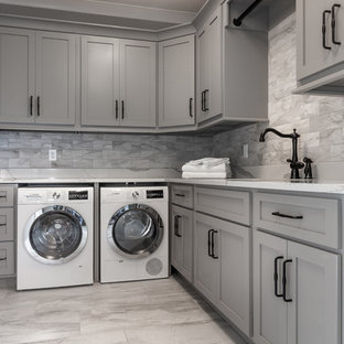 This is an example of a large classic l-shaped separated utility room in Atlanta with a submerged sink, recessed-panel cabinets, grey cabinets, marble worktops, grey walls, ceramic flooring, a side by side washer and dryer, grey floors and grey worktops.