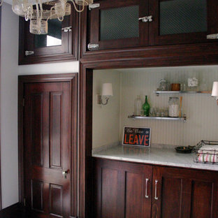 This is an example of a large classic single-wall utility room in Chicago with a belfast sink, shaker cabinets, dark wood cabinets, marble worktops, grey walls, ceramic flooring, a concealed washer and dryer, green floors and white worktops.