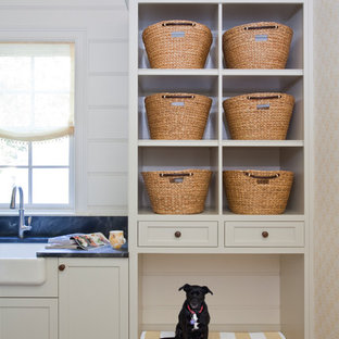Inspiration for a transitional cork floor laundry room remodel in Other with a farmhouse sink, soapstone countertops and white walls