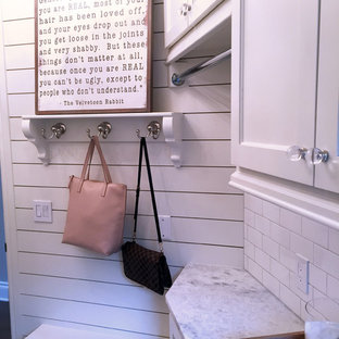 Inspiration for a timeless porcelain floor laundry room remodel in Austin with an undermount sink, shaker cabinets, white cabinets, quartzite countertops and white walls
