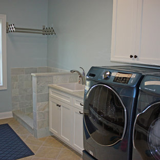 Utility room - large craftsman single-wall porcelain floor and beige floor utility room idea in Chicago with a drop-in sink, recessed-panel cabinets, white cabinets, granite countertops, a concealed washer/dryer and gray walls