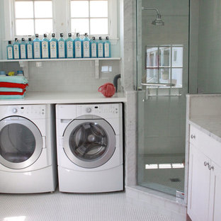 Photo of a large beach style l-shaped utility room in Boston with an undermount sink, shaker cabinets, white cabinets, marble benchtops, blue walls, ceramic floors, a side-by-side washer and dryer, yellow floor and white benchtop.
