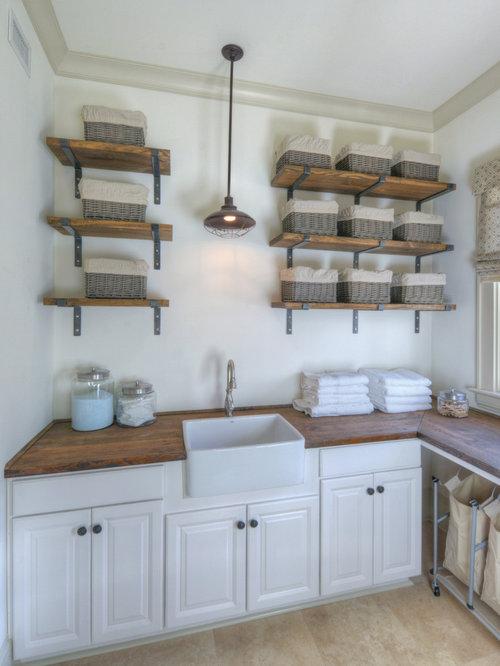 maritimer hauswirtschaftsraum mit landhaussp le ideen design bilder houzz. Black Bedroom Furniture Sets. Home Design Ideas