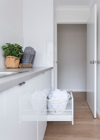 Scandinavian Laundry Room by Red Lily Renovations