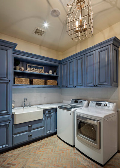 Mediterranean Laundry Room by LaBlonde Development