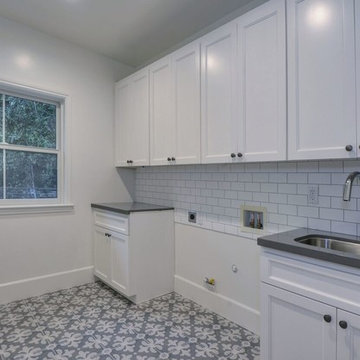 Spanish contemporary - laundry room with geometric tile floor