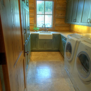 Example of a mountain style u-shaped ceramic floor and beige floor laundry room design in Other with a farmhouse sink, quartzite countertops, recessed-panel cabinets, green cabinets and yellow walls