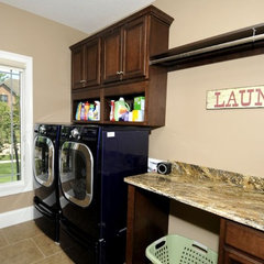 traditional laundry room by Design Homes & Development Co.