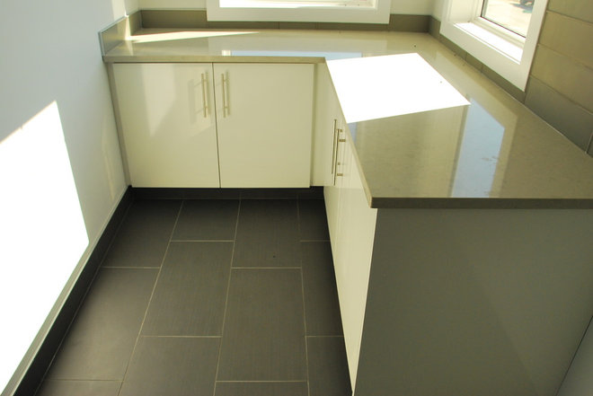 Modern Laundry Room by Edmonton Kitchen & Bath Cabinet Inc.